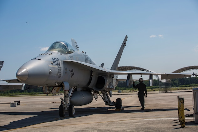A Marine performs a pre-flight inspection on an F/A-18C Hornet aboard Marine Corps Air Station Beaufort May 3. Marine Fighter Attack Squadron 251 will be participating in a weapons systems Evaluation Program at Tyndall Air Force Base, Fla. May 6-20. The Marine is with VMFA-251.