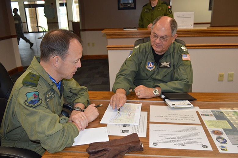 01.	BGen Alain Pelletier, Continental U.S. Aerospace Defense Region Deputy Commander, listens as Florida Wing Civil Air Patrol Lt. Col. Larry Fernald briefs a point about the CAP mission they are going to fly from Tyndall Air Force Base. Pelletier flew an orientation flight May 2 with Fernald to familiarize himself about the CAP missions in the region that include fire watch in the Eglin Air Force Base, Fla., area and search and rescue upon request. (USAF Photo released by Mary McHale)