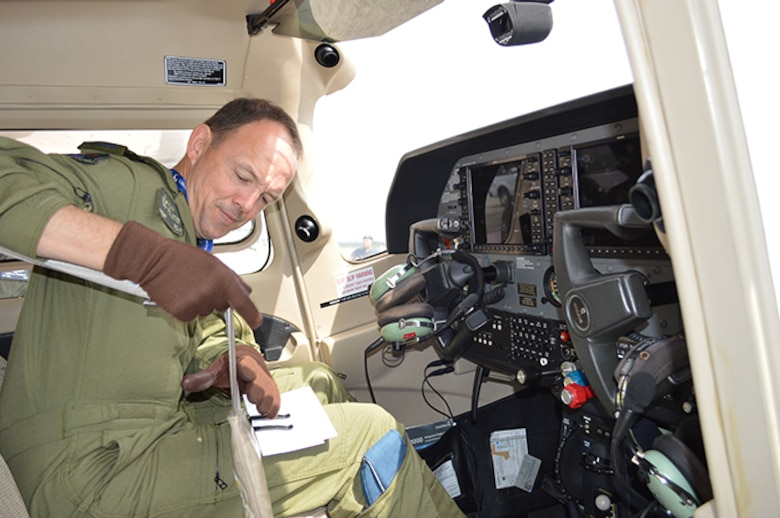 02.	BGen Alain Pelletier, Continental U.S. Aerospace Defense Region Deputy Commander, straps himself into a Florida Wing Civil Air Patrol Cessna 172, prior to a CAP mission-orientation flight May 2. Pelletier flew the mission with Florida Wing CAP Lt. Col. Larry Fernald to familiarize himself about the CAP missions in the region that include fire watch in the Eglin Air Force Base, Fla., area and search and rescue upon request. (USAF Photo released by Mary McHale)