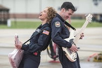 Air Force Tech. Sgt. Michelle Hooper, left, and Staff Sgt. Jordan Kimble perform with Full Spectrom, a six-piece band, in front of airmen at Langley Air Force Base, Va., May 4, 2016. The band is from the Air Force Heritage of America Band. Air Force photo by Senior Airman Kayla Newman