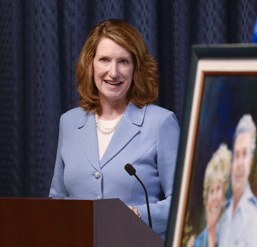 Under Secretary of the Air Force Lisa Disbrow talks about the achievements of Col. William Liquori Jr. and his wife, Amy, before she presents them the 2015 General and Mrs. Jerome F. O'Malley Award during a ceremony in the Pentagon May 3, 2016.  The award was earned during the Liquoris' time leading the 50th Space Wing at Schriever Air Force Base, Colo. (U.S. Air Force photo/Andy Morataya)