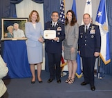 Under Secretary of the Air Force Lisa Disbrow and Air Force Vice Chief of Staff Gen. David L. Goldfein present the 2015 General and Mrs. Jerome F. O' Malley Award to Col. William Liquori Jr. and his wife, Amy, during a ceremony in the Pentagon, May 3, 2016.  The award was earned during the Liquoris' time leading the 50th Space Wing at Schriever Air Force Base, Colo. (U.S. Air Force photo/Andy Morataya)