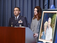 Col. William Liquori Jr. and his wife, Amy, speak after they are presented the 2015 General and Mrs. Jerome F. O' Malley Award during a Pentagon ceremony May 3, 2016. The award was earned during the Liquoris' time leading the 50th Space Wing at Schriever Air Force Base, Colo. (U.S. Air Force photo/Andy Morataya)