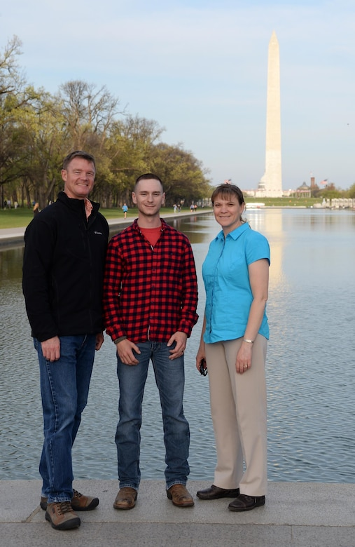 Staff Sgt. Cody Sparks, center, Air Education and Training Command Airman of the Year, poses with Col. Thomas Shank, left, 47th Flying Training Wing commander, and Chief Master Sgt. Teresa Clapper, right, 47th FTW command chief, in front of the Washington Monument April 11, 2016. The trio visited Capitol Hill to inform congressional leadership about Laughlin Air Force Base.