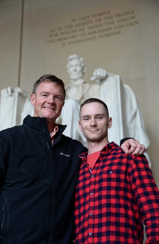 Staff Sgt. Cody Sparks, right, Air Education and Training Command Airman of the Year, poses with Col. Thomas Shank, left, 47th Flying Training Wing commander, in front of the Lincoln Memorial April 11, 2016. During a visit to Capitol Hill to inform congressional leadership about Laughlin Air Force Base, Sparks toured memorials learning about Air Force heritage from his wing commander.