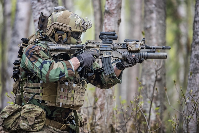 An airman participates in a mass-casualty training event at Joint Base Elmendorf-Richardson, Alaska, May 4, 2016. The exercise consisted of a tactical foot patrol in the woods on the joint base, where the rescue team members searched for reported casualties. The airman is assigned to the Alaska Air National Guard's 212th Rescue Squadron. Air National Guard photo by Staff Sgt. Edward Eagerton