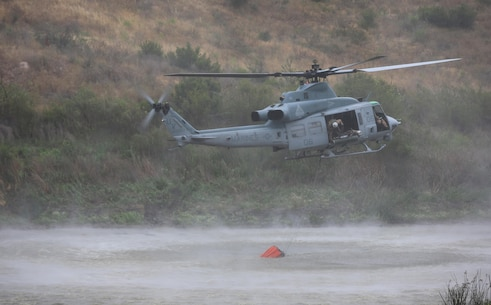 Camp Pendleton hosts the Wildland Firefighting Exercise 2016 at Las Pulgas Lake, May 5. The Wildland Firefighting Exercise 2016 combines elements of aviation and ground units from Camp Pendleton, 3rd Marine Air Wing, Navy Region Southwest, The California Department of Forestry and Fire Protection, and the San Diego's Sheriff's Department. (Marine Corps photo by Lance Cpl. Emmanuel Necoechea/RELEASED)