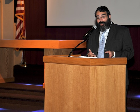 Rabbi Yisroel Hahn speaks with Airmen during a Holocaust Remembrance Day event May 4, 2016 at Fairchild Air Force Base, Wash. Hahn was invited to guest speak at the event to provide Airmen with insight and history of the Holocaust. Members of Team Fairchild gathered at the chapel to remember and honor those who suffered and died during the Holocaust. (U.S. Air Force photo/ Staff Sgt. Samantha Krolikowski)