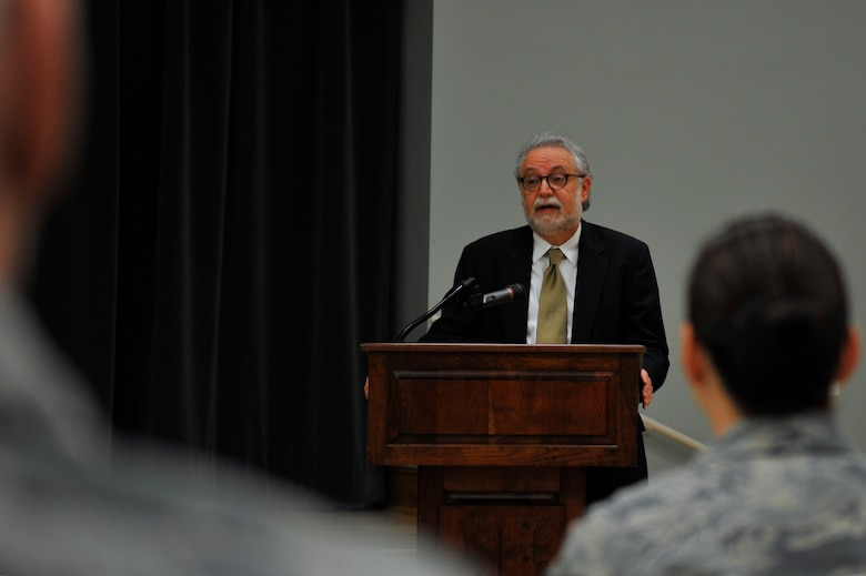 Garrick Feldman, publisher of the Combat Airlifter base newspaper, shares his mother's story of being a Holocaust survivor May 5, 2016, at Little Rock Air Force Base. Feldman spoke on his mother's behalf in hopes that she and those who survived are never forgotten. (U.S. Air Force photo by Kevin E. Sommer Giron)
