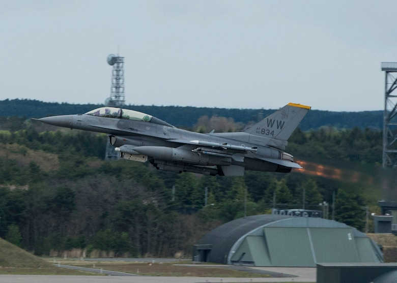 An F-16D Fighting Falcon takes off at Misawa Air Base, Japan, May 4, 2016. The F-16s at Misawa uphold the 35th Fighter Wing's mission, which is Suppression of Enemy Air Defenses. Pilots aim to destroy surface-to-air missile sites by detecting them through radar and using self-sacrificing maneuvers to draw them away from allied aircraft. The F-16D differs from the F-16B model in that is a two-seat aircraft used for training missions and incentive flights. (U.S. Air Force photo by Airman 1st Class Jordyn Fetter)