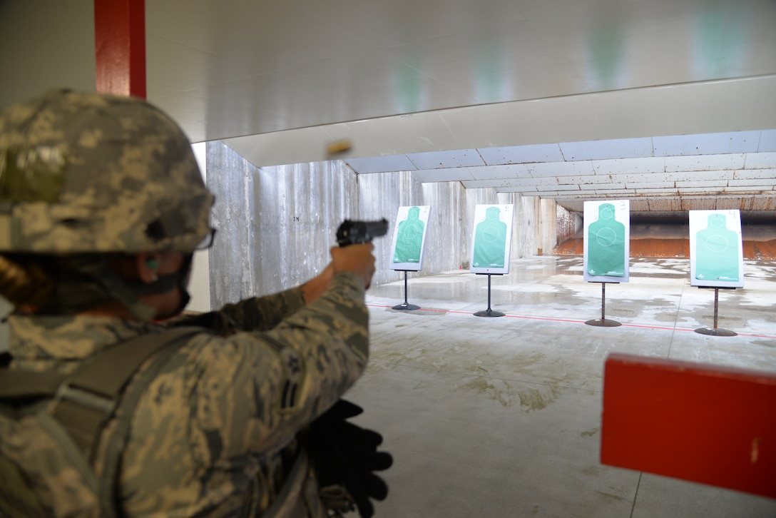 U.S Air Force Airman 1st Class Jasmin Amaral, 18th Security Forces Squadron patrolman, fires her M9 pistol during a qualification course at the combat arms training and maintenance facility April 28, 2016, at Kadena Air Base, Japan. Training from CATM is required when Airmen deploy, move within a 90-day window, or have line of duty requirements. (U.S. Air Force photo by Staff Sgt. Benjamin Sutton)