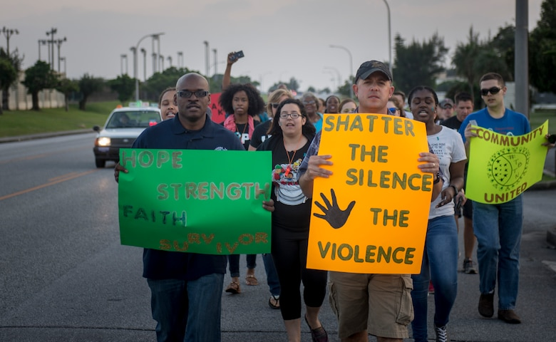 Women and men march shoulder-to-shoulder during the Take Back the Night April, 29, 2016, at Kadena Air Base, Japan. Kadena's Take Back the Night is a rally, a march and a time to reflect. (U.S. Air Force photo by Senior Airman Omari Bernard)