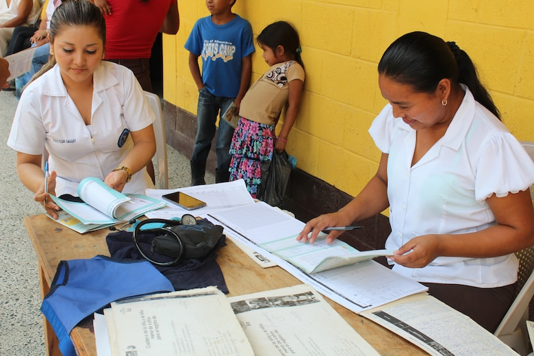 Guatemalan Public Health Services representatives check vaccination cards during a joint Medical Readiness Training Exercise at Jocotán, Chiquimula, Guatemala, April 29, 2016. MEDRETES serve to validate a service member's ability to provide care under austere conditions in remote locations, and also provide an opportunity for them to work side by side with foreign counterparts while providing much-needed medical care, developing partnerships and long-lasting relationships with other nations. (U.S. Army photo by Maria Pinel)