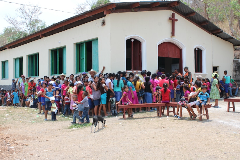 Guatemalan families wait outside a local church to receive a preventive health class during a Medical Readiness Training Exercise in Jocotán, Chiquimula, Guatemala, April 29, 2016. After concluding the initial class, patients receive soap, vitamins and de-worming medication, and then pass on to the screeners and medical providers.  (U.S. Army photo by Maria Pinel)