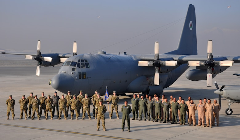 Members of the 538th Air Expeditionary Advisory Squadron and the Afghanistan Air Force's 373rd Fixed Wing Squadron pose for a group photo. U.S. Air National Guard and coalition advisors are evaluating and instructing Afghanistan Air Force C-130H Hercules aircraft operators as they build a mission-capable aviation squadron from the ground up. (U.S. Air Force photo by Capt. Edith Sakura, 538th Air Expeditionary Wing/released)