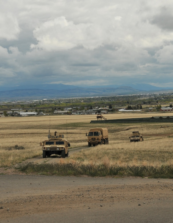 Airmen from the 120th Mission Support Group, Montana Air National Guard, perform convoy training during a field training exercise April 30, 2016, at Fort Harrison in Helena, Mont. The Airmen were able to meet readiness requirements and sharpen contingency skills in a simulated combat environment during the training. (U.S. Air National Guard photo by Tech. Sgt. Christy Mason)