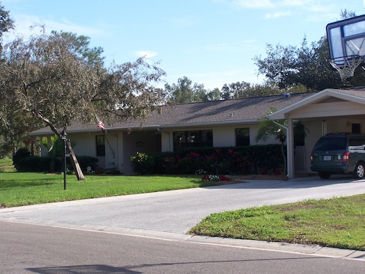 The home of retired Col. Robert Moriarty and his family at MacDill Air Force Base, Florida, in 2006, when base housing was still government-owned and operated. The four-bedroom, two-bathroom home was conveyed to Clark Realty in 2007 under Military Housing Privatization Initiative legislation. The Moriarty's old home is no longer standing. It was one of the ones demolished by Clark Realty during the project's initial development phase to make room for higher-quality new homes, managed by Harbor Bay. (Photo courtesy of the Moriarty family)