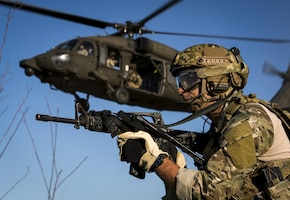 Special Tactics Training Squadron Airmen from the 24th Special Operations Wing fast rope from a U.S. Army UH-60 Black Hawk at Hurlburt Field, Fla., May 4, 2016, during Emerald Warrior 16. Emerald Warrior is a U.S. Special Operations Command sponsored mission rehearsal exercise during which joint special operations forces train to respond to real and emerging worldwide threats. (U.S. Air Force photo by Senior Airman Trevor T. McBride)
