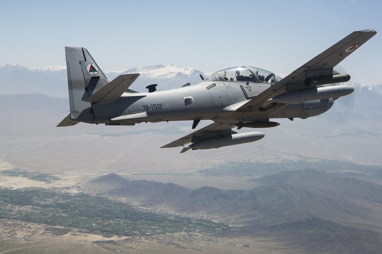 An A-29 Super Tucano flies over Kabul, Afghanistan, April 28, 2016. The highest priority skillset for the Afghan Air Force A-29 pilots is the effective execution of close air support (CAS). Pilots are trained to employ rockets, precision-guided bombs, general purpose bombs, and strafe. It will employ a variety of weapons to do this mission: .50 cal machine guns, 2.75 inch rockets, 250 and 500 pound general purpose and guided bombs. (U.S. Air Force photo by Staff Sgt. Larry Reid, Jr.,released)