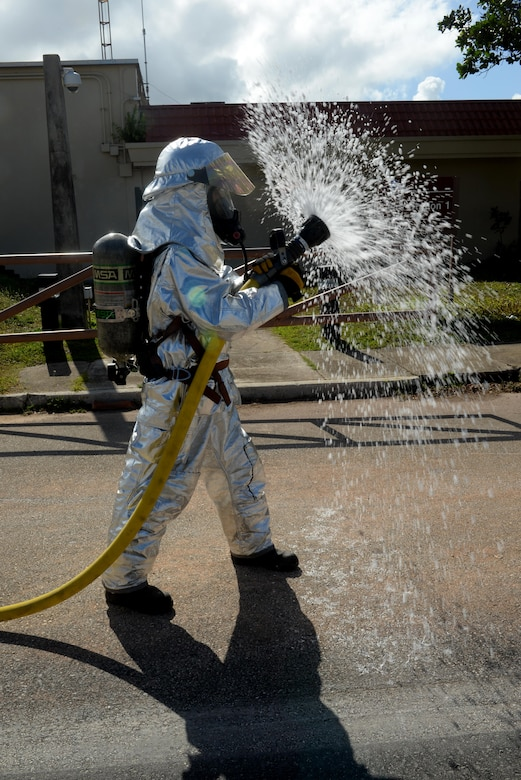 Airman 1st Class Kaleb Miranda, 36th Civil Engineer Squadron fire protection apprentice, utilizes a wide water spray from a firehose during a training course May 4, 2016, at Andersen Air Force Base, Guam. Miranda, along with his peers completed an obstacle course to test his strength and endurance using firefighting techniques while wearing personal protective equipment and a self-contained breathing apparatus. (U.S. Air Force photo by Airman 1st Class Alexa Ann Henderson)