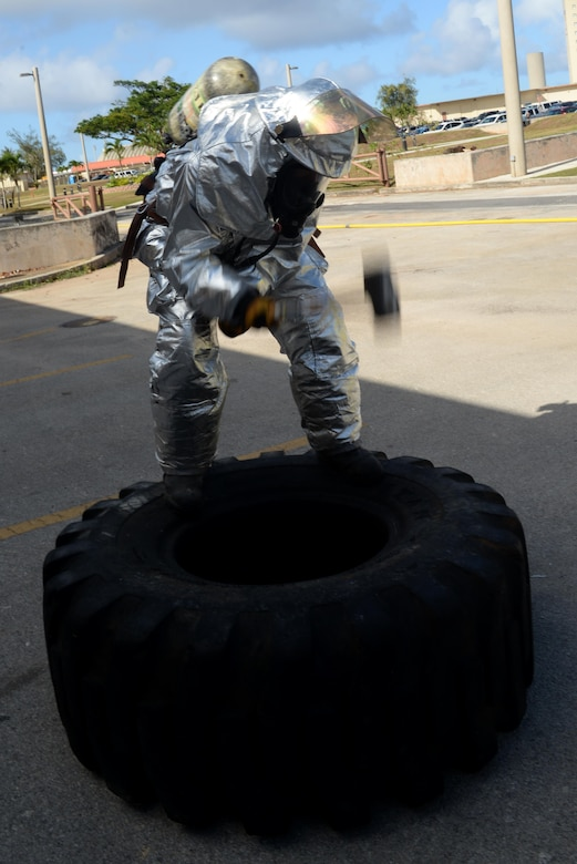 Airman 1st Class Kaleb Miranda, 36th Civil Engineer Squadron fire protection apprentice, uses a sledgehammer during a firefighting obstacle course May 4, 2016, at Andersen Air Force Base, Guam. The course tested Airmen's ability to run with firehoses, dragging a dummy and climbing up and down a ladder while wearing personal protective equipment and a self-contained breathing apparatus. (U.S. Air Force photo by Airman 1st Class Alexa Ann Henderson)