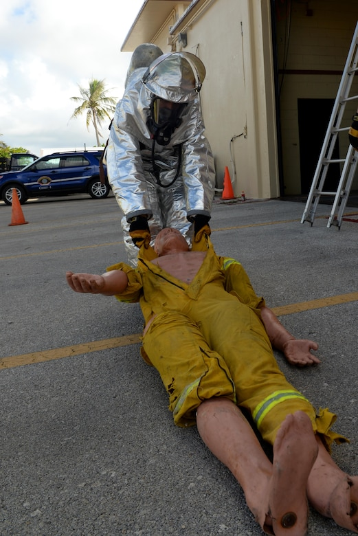 Airman 1st Class Kaleb Miranda, 36th Civil Engineer Squadron fire protection apprentice, drags a dummy across a parking lot during a firefighting obstacle course May 4, 2016, at Andersen Air Force Base, Guam. An obstacle course tested Airmen's ability to run with firehoses, personnel rescue and climbing up and down a ladder while wearing personal protective equipment and a self-contained breathing apparatus. (U.S. Air Force photo by Airman 1st Class Alexa Ann Henderson)