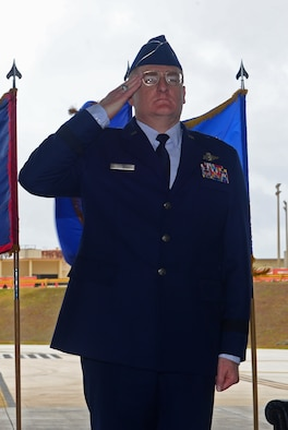 Brig. Gen. Douglas Cox, the new 36th Wing commander, renders his first salute during a change of command ceremony May 6, 2016, at Andersen Air Force Base, Guam. A change of command is a military tradition that represents a formal transfer of authority and responsibility for a unit from one commanding officer to another. (U.S. Air Force photo by Senior Airman Joshua Smoot)