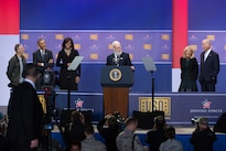 Former Late Show host and comedian David Letterman entertains at the president's lectern as, from left, former Daily Show host and comedian Jon Stewart, President Barack Obama, First Lady Michelle Obama, Dr. Jill Biden, and Vice President Joe Biden listen, during the celebration of the 75th anniversary of the USO and the 5th anniversary of Joining Forces at Joint Base Andrews in Washington, D.C., May 5, 2016. Joining Forces is an initiative to help military, veterans and their families founded by Dr. Jill Biden and First Lady Michelle Obama. DoD News photo by EJ Hersom