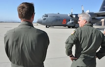 Col. Erich Novak (right), 302nd Airlift Wing vice commander, looks on as a 302nd AW C-130H3 Hercules and its Air Force Reserve crew prepare to taxi for take off as the flying portion of the 2016 Modular Airborne Fire Fighting System certification week begins in Ventura, Calif., May 3, 2016. The annual certification week, taking place May 2-6, brings together members of the Air National Guard and Air Force Reserve to be certified on operating MAFFS in the event of being called upon to support wildland fire containment. The wings include North Carolina's 145th AW; California's 146th AW; Wyoming's 153rd AW; and the AF Reserve's 302nd AW. (U.S. Air Force photo/2nd Lt. Stephen J. Collier)