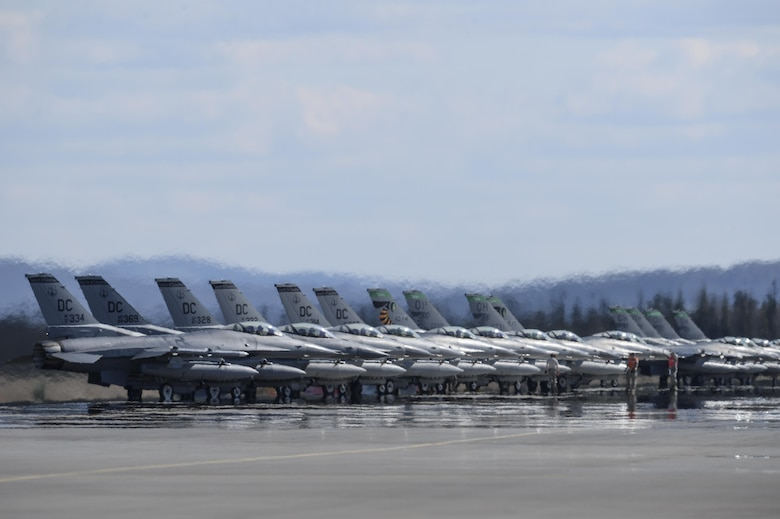 F-16 Fighting Falcons assigned to the 121st Fighter Squadron at Joint Base Andrews, Md., and the 112th FS from Toledo Air National Guard Base, Ohio, stand by for launch May 4, 2015, during Red Flag-Alaska 15-2 at Eielson Air Force Base, Alaska. RF-Alaska 15-2 enabled units from around the globe to conduct live-fire training, utilizing more than 67,000 square miles of airspace over the Joint Pacific Alaska Range Complex. (U.S. Air Force photo/Senior Airman Peter Reft)