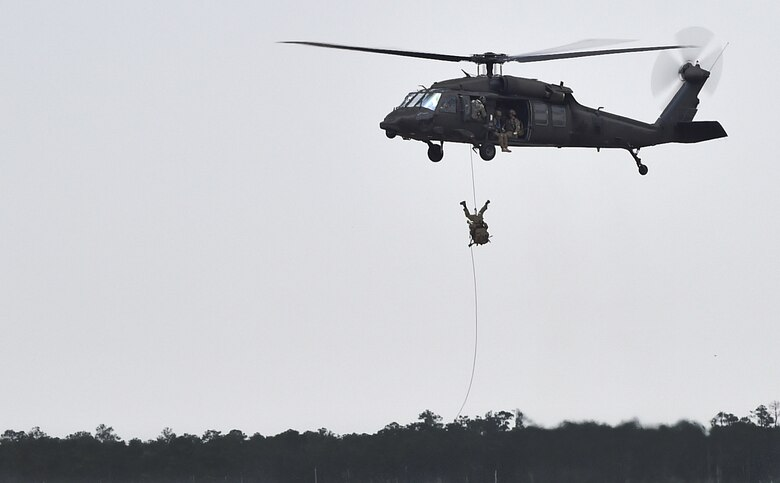 Soldiers fast rope from a UH-60 Black Hawk during Emerald Warrior 16 on May 3, 2016, at Hurlburt Field, Fla. Emerald Warrior 16 is a U.S. Special Operation Command sponsored mission rehearsal exercise in which joint special operations forces train to respond to real and emerging worldwide threats. (U.S. Air Force photo/Senior Airman Logan Carlson)