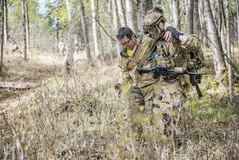 Members of the Alaska Air National Guard's 212th Rescue Squadron participate in a mass casualty training event on Joint Base Elmendorf-Richardson, Alaska, May 4, 2016. The exercise consisted of a tactical foot patrol in the woods, where rescue team members reported casualties. During the movement, the team was ambushed by opposition forces, causing them to react to contact, suppress enemy fire, and call for close air support. This training prepares the Air Force's elite rescue personnel for the types of high-risk rescue missions they conduct when deployed in defense of their nation. (U.S. Air National Guard photo/Staff Sgt. Edward Eagerton)
