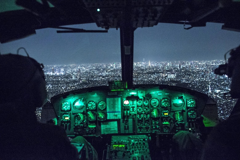 Capt. Jonathan Bonilla and 1st Lt. Vicente Vasquez, 459th Airlift Squadron UH-1N Huey pilots, fly over Tokyo after completing night training April 25, 2016. The 459th AS frequently trains on a multitude of scenarios in preparation for potential real-world contingencies and operations. (U.S. Air Force photo/Yasuo Osakabe)