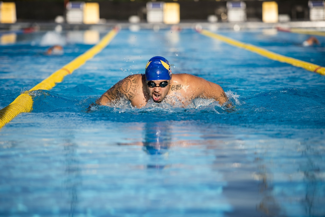 Christian Perryman, an Airman and Team U.S.A. athlete, warms up before 2016 Invictus Games practice swimming heats at the ESPN Wide World of Sports complex at Walt Disney World in Orlando, Fla., May 5, 2016. Fifteen countries are competing in the 2016 Invictus Games and there are 108 medals to be earned in the swimming competitions. (U.S. Air Force photo/Senior Master Sgt. Kevin Wallace)
