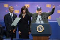 Former Daily Show host Jon Stewart tells jokes as President Barack Obama and First Lady Michelle Obama look on during the comedy show celebrating the 75th anniversary of the USO and the 5th anniversary of the Joining Forces initiative at Joint Base Andrews near Washington, D.C. May 5, 2016. DoD photo by E.J. Hersom