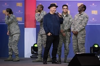 Airmen react to comedian Jeff Ross during the comedy show in celebration of the 75th anniversary of the USO and the 5th anniversary of the Joining Forces initiative at Joint Base Andrews near Washington, D.C., May 5, 2016. Joining Forces was launched by First Lady Michelle Obama and Dr. Jill Biden to help service members, veterans and their families. DoD News photo by E.J. Hersom