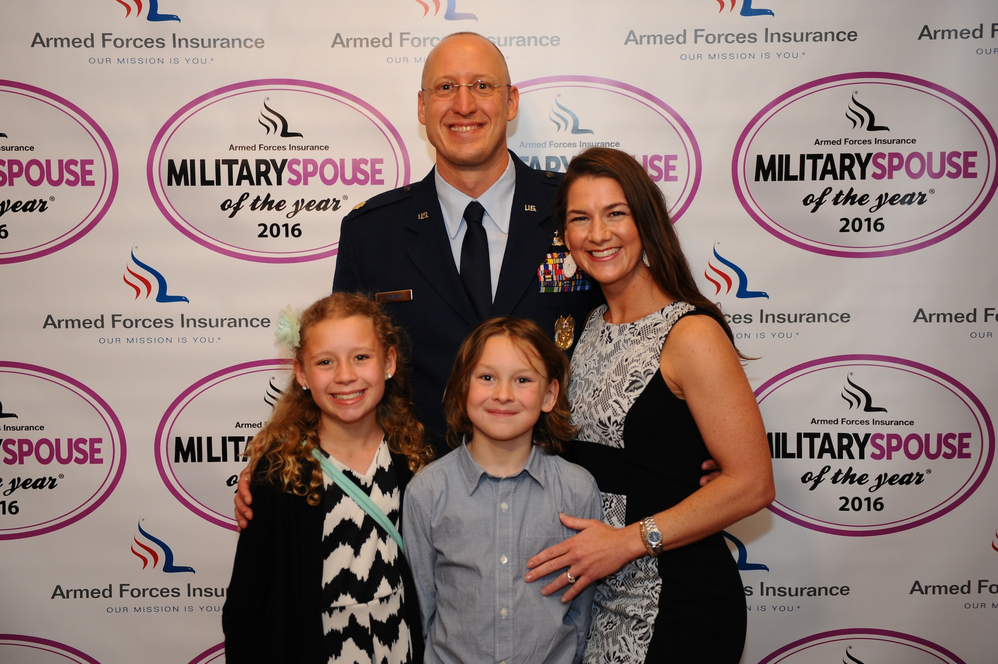 Maj. Robert Aikman, wife Michelle, and children Cole and Annika, attended the Military Spouse of the Year award luncheon May 5, 2016, at Fort Myer in Arlington, Va. During the luncheon, Michelle was recognized as the Air Force's military spouse of the year. The Aikmans are stationed at Fairchild Air Force Base, Wash. (U.S. Air Force photo/Tech. Sgt. Bryan Franks)