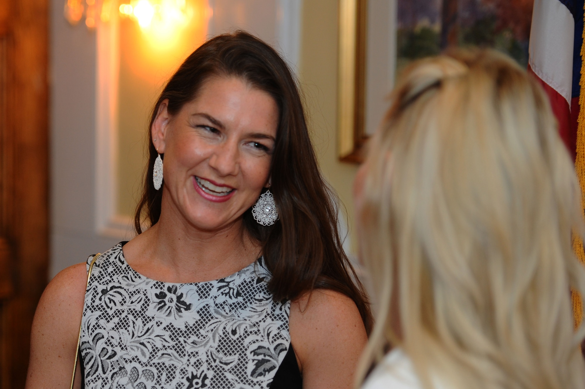 Michelle Aikman, the 2016 Air Force Spouse of the Year, speaks with a fellow spouse of the year nominee during the Military Spouse of the Year award luncheon May 5, 2016, at Fort Myer in Arlington, Va. Aikman aims to be a voice for all spouses navigating challenges in their lives. (U.S. Air Force photo/Tech. Sgt. Bryan Franks)