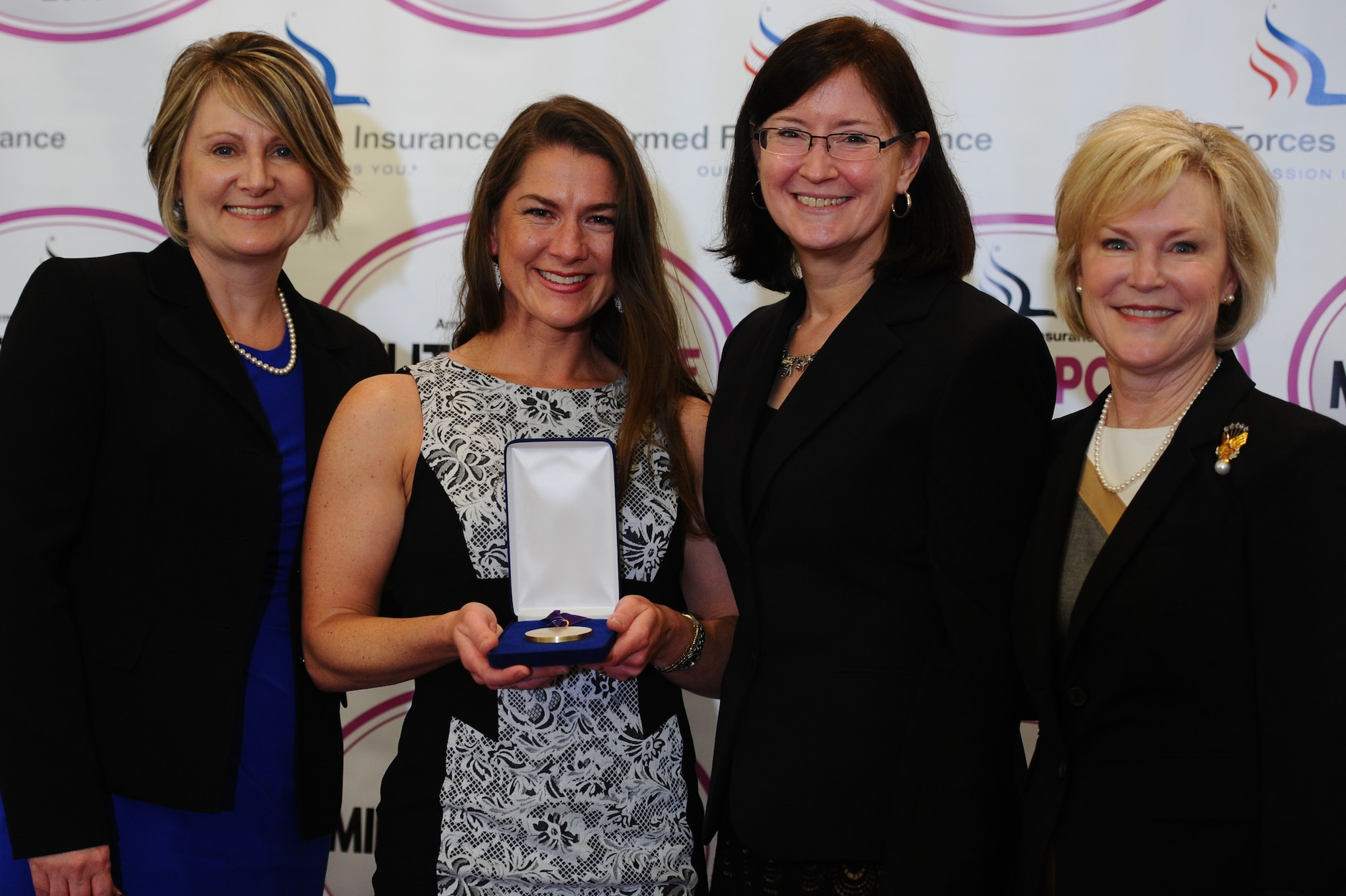 Military spouses Marie Hotaling, Michelle Aikman, Ricki Selva and Dawn Goldfein attended the Military Spouse of the Year award luncheon May 5, 2016, at Fort Myer in Arlington, Va. More than 100 military spouses attended the event. (U.S. Air Force photo/Tech. Sgt. Bryan Franks)