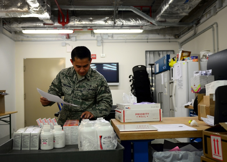 Staff Sgt. Mark Tumbagon, 31st Medical Support Squadron warehouse NCO in charge, inventories supplies, May 2, 2016, at Aviano Air Base, Italy. The Medical Logistics Flight is made up of six elements including biomedical equipment repair, contract services, facility management, customer service, medical equipment management and acquisitions that work hand-in-hand to support 64 medical units on a daily basis. (U.S. Air Force photo by Senior Airman Areca T. Bell/Released)