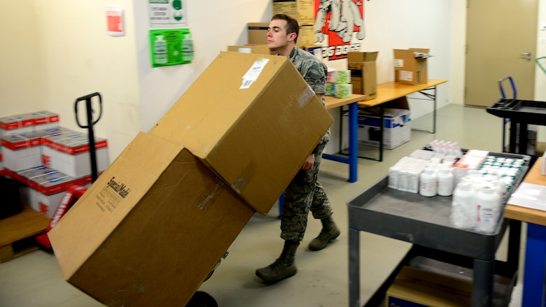 Airman 1st Class Samuel Van Diest, 31st Medical Support Squadron customer service representative, moves stock items, May 2, 2016, at Aviano Air Base, Italy. The Medical Logistics Flight is made up of six elements including biomedical equipment repair, contract services, facility management, customer service, medical equipment management and acquisitions that work hand-in-hand to support 64 medical units on a daily basis. (U.S. Air Force photo by Senior Airman Areca T. Bell/Released)