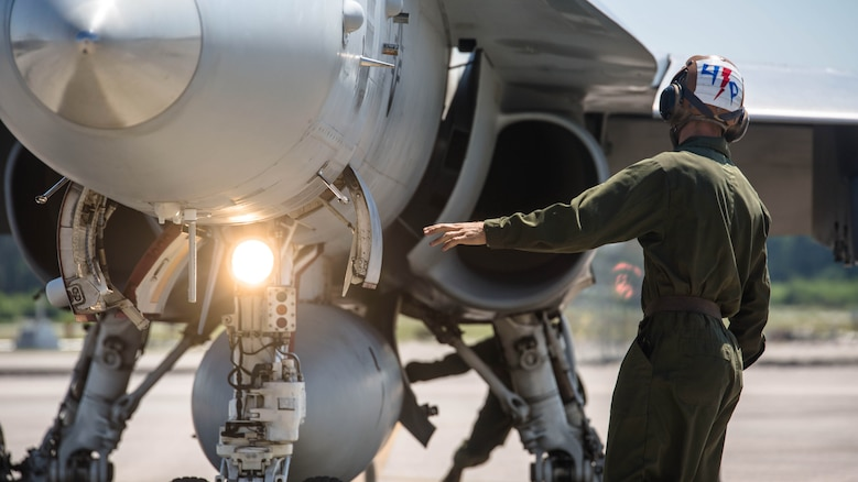A maintainer stands in front of an F/A-18C Hornet on the flight line at Marine Corps Air Station Beaufort, South Carolina, May 4,2016. Marine Fighter Attack Squadron 251 is participating in a Weapons Systems Evaluation Program at Tyndall Air Force Base, Florida, May 6-20,2016. The program gives pilots experience with flying against real aircraft outside a simulation. The real world training helps Marines be tactically proficient and prepared to deploy.