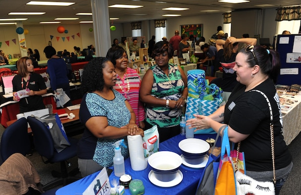 Rebecca Blanton, spouse of Staff Sgt. Micah Blanton, 81st Force Support Squadron manpower technician, receives information from Keesler Family Housing members during Pamper Me Day at the Sablich Center May 5, 2016, Keesler Air Force Base, Miss. Keesler's Airman & Family Readiness Center has hosted the event for the past 12 years, offering spouses free manicures, hair styling tips and information and business booths. (U.S. Air Force photo by Kemberly Groue)