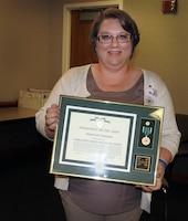 Kristen Hansen accepts award as Sacramento District Regulator of the Year. (Photo courtesy Mike Jewell)