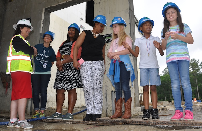 A few Diamond Elementary School students view the makings of an outdoor amphitheater at the construction site of the new school May 3. Thirteen contest winners of Archer Western Contractor's poster contest toured the site currently under construction at Fort Stewart, Georgia. Diamond students from kindergarten through sixth-grade submitted posters emphasizing safety themes in recognition of Safety Week celebrated May 2-6. The winning submissions were printed on the firm's calendar that will be available throughout the Fort Stewart community.