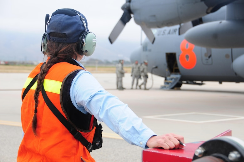 Assistant Air Base Fueler from the Santa Maria Air Tanker Base Elena Rios with U.S. Forest Service monitors water being pumped into a MAFFS unit on a C-130 air tanker during training at the 146th Airlift Wing in Port Hueneme, California on May 4, 2016. Air National Guard and Reserve units from across the U.S. convened for MAFFS (Modular Airborne Fire Fighting Systems)annual certification and training this week to prepare for the upcoming fire season in support of U.S. Forest Service.