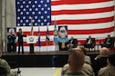 Col. Anthony Polashek, 934th Airlift Wing commander, pays tribute to Medal of Honor recipients Thomas Kelley, Robert Patterson and Harold Fritz. (Air Force Photo/Paul Zadach)