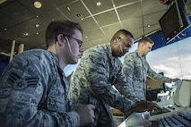 From left, U.S. Air Force Senior Airmen Robert Wallace, Anthony Marshall, and Eric Smith, all 354th Operations Support Squadron air traffic controllers, manage the air space around Eielson Air Force Base, Alaska, May 5, 2016, during RED-FLAG Alaska (RF-A) 16-1. Eielson air traffic controllers must know how to operate radio equipment to relay flight and landing instructions, weather reports and safety information to pilots. (U.S. Air Force photo by Staff Sgt. Joshua Turner/Released)