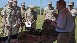 Marines learn about the Joint Infantry Company Prototype during the Expeditionary Energy Concepts symposium at Marine Corps Base Camp Pendleton, California, May 3, 2016. The JIC-P is a wearable energy management system that uses multiple sources, including kinetic harvesting, to recharge batteries in radios and other equipment that cuts down the amount of weight each Marine has to carry and eliminates the need to frequently resupply forward units with fresh batteries. E2C features new technologies developed by outside companies to improve the reach and effectiveness of the Marine Corps. The three-day event also gives Marines who would work with the technology on a daily basis the opportunity to identify possible areas for improvement.