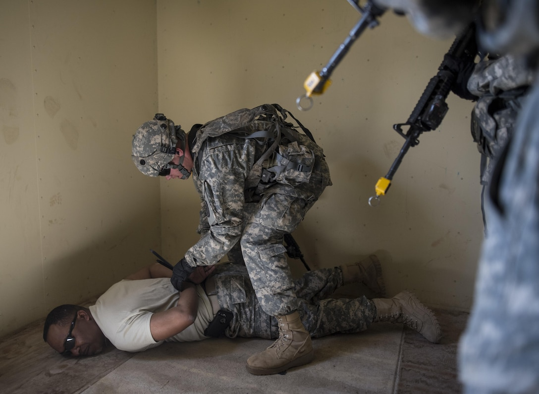 A team of U.S. Army Reserve military police Soldiers from the 56th Military Police Company (Combat Support), of Mesa, Arizona, find and detain a high-value target during a cordon and search training lane at Fort Hunter-Liggett, California, May 4. Approximately 80 units from across the U.S. Army Reserve, Army National Guard and active Army are participating in the 84th Training Command's second Warrior Exercise this year, WAREX 91-16-02, hosted by the 91st Training Division at Fort Hunter-Liggett, California. (U.S. Army photo by Master Sgt. Michel Sauret)